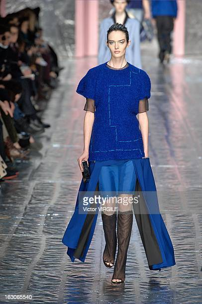 A model walks the runway during the Acne Studios Fall/Winter 2013 ReadytoWear show as part of Paris Fashion Week on March 2 2013 in Paris France