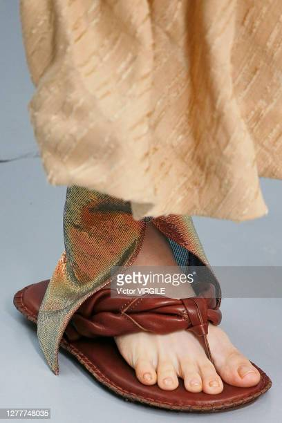 Model walks the runway during the Acne Studios Ready to Wear Spring/Summer 2021 fashion show as part of Paris Fashion Week on September 30, 2020 in...