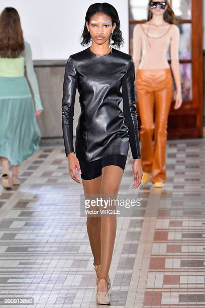 A model walks the runway during the Acne Studios Ready to Wear Womenswear Spring Summer 2019 fashion show during the Paris Fashion Week on July 1...