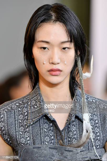 Model walks the runway during the ACNE STUDIOS womens wear Spring/Summer 2020 fashion show as part of Paris Fashion Week on June 30, 2019 in Paris,...