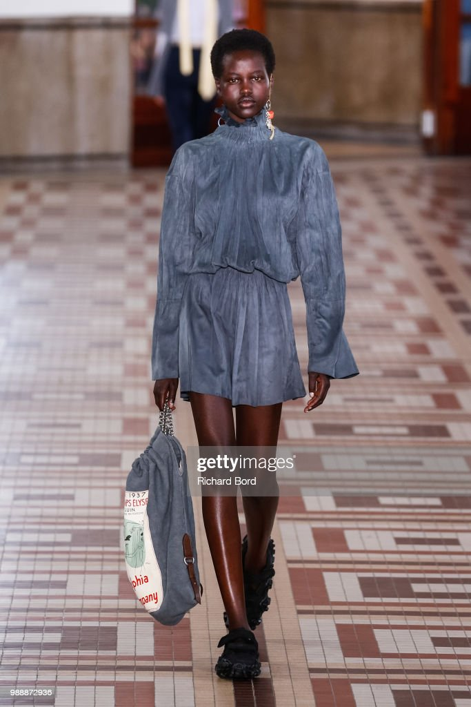 model-walks-the-runway-during-the-acne-studios-womenswear-spring-picture-id988872936