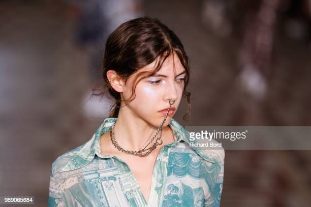 A model walks the runway during the Acne Studios Womenswear Spring Summer 2019 during the Paris Fashion Week on July 1 2018 in Paris France