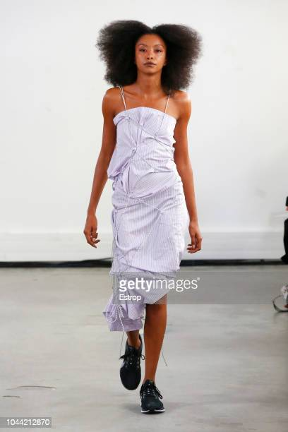A model walks the runway during the Afterhomework show as part of the Paris Fashion Week Womenswear Spring/Summer 2019 on September 25 2018 in Paris...