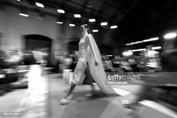 Model walks the runway during the Afterpay Australian Fashion Week 2021 Resort '22 Collections at Carriageworks on June 02, 2021 in Sydney, Australia.