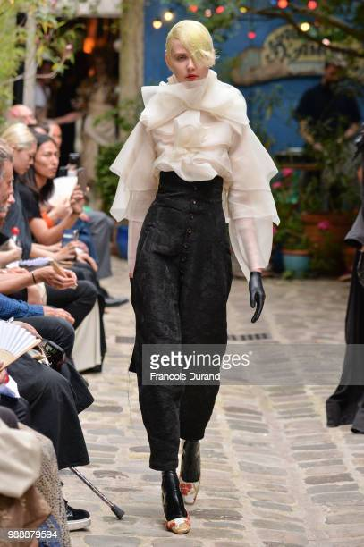 A model walks the runway during the Aganovich Haute Couture Fall Winter 2018/2019 show as part of Paris Fashion Week on July 1 2018 in Paris France