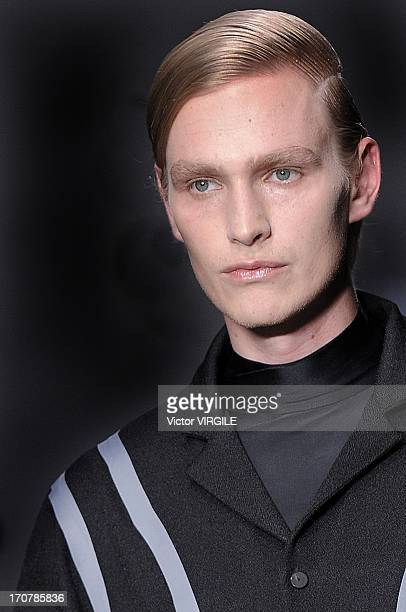 Model walks the runway during the Agi & Sam show during the London Collections: MEN Spring Summer 2014 at Victoria House on June 16, 2013 in London,...