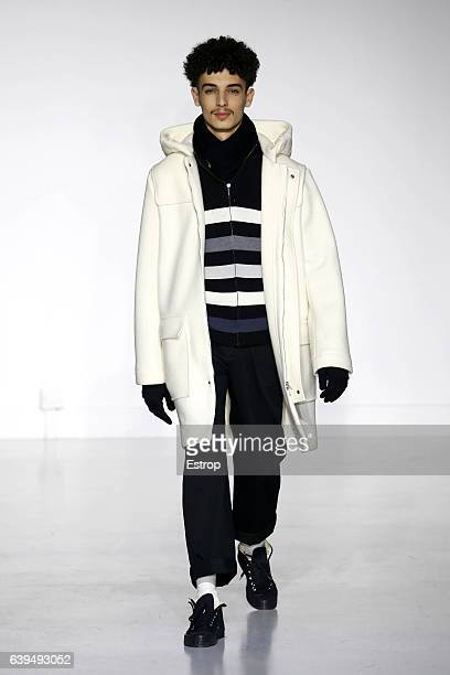 A model walks the runway during the Agnes B designed by Agnes Trouble Menswear Fall/Winter 20172018 show as part of Paris Fashion Week on January 22...