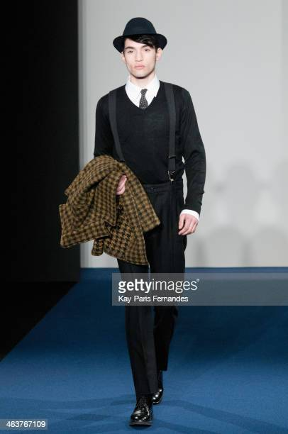A model walks the runway during the Agnes B Menswear Fall/Winter 20142015 show as part of Paris Fashion Week on January 19 2014 in Paris France