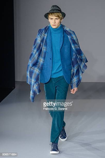 A model walks the runway during the Agnes B Menswear Fall/Winter 20162017 show as part of Paris Fashion Week on January 24 2016 in Paris France