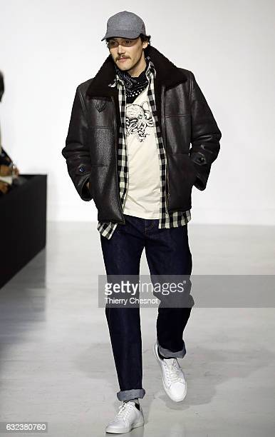 A model walks the runway during the Agnes B Menswear Fall/Winter 20172018 show as part of Paris Fashion Week on January 22 2017 in Paris France
