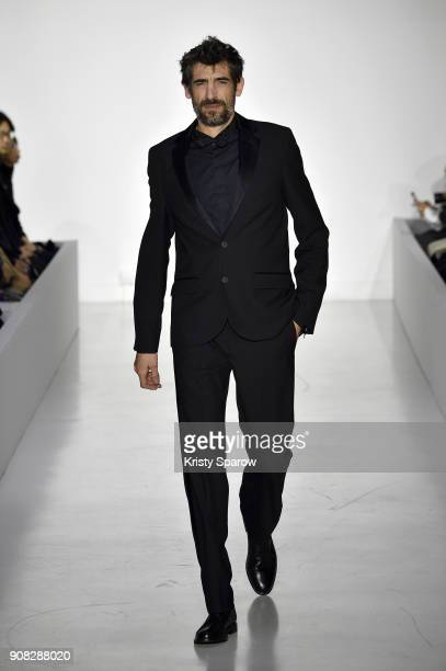 A model walks the runway during the agnes b Menswear Fall/Winter 20182019 show as part of Paris Fashion Week on January 21 2018 in Paris France