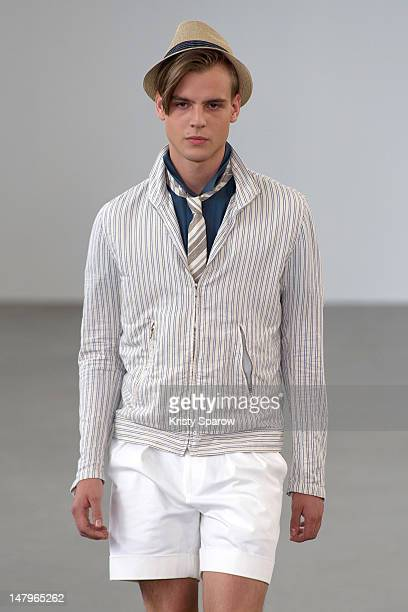 A model walks the runway during the Agnes B Menswear Spring / Summer 2013 show as part of Paris Fashion Week at Maison des Metallos on July 1 2012 in...