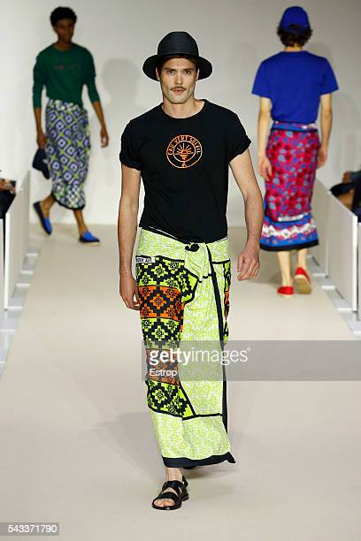 A model walks the runway during the Agnes B Menswear Spring/Summer 2017 show designed by Agnes Trouble as part of Paris Fashion Week on June 26 2016...