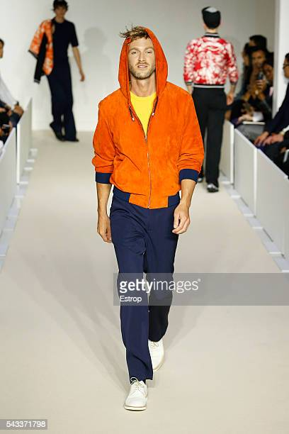 Model walks the runway during the Agnes B. Menswear Spring/Summer 2017 show designed by Agnes Trouble as part of Paris Fashion Week on June 26, 2016...