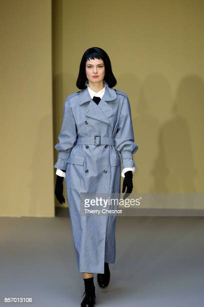 A model walks the runway during the Agnes B Paris show as part of the Paris Fashion Week Womenswear Spring/Summer 2018 on October 3 2017 in Paris...