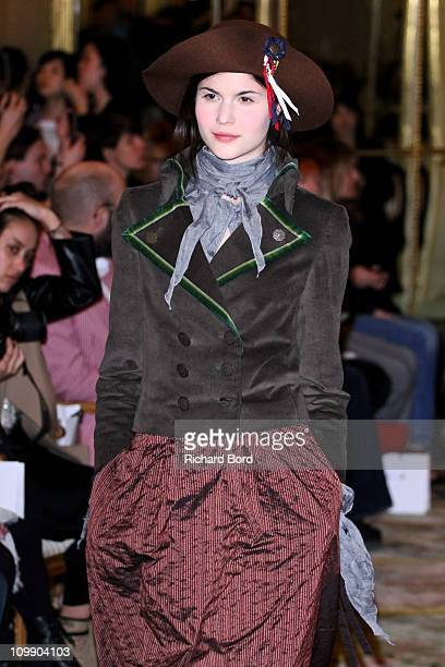 Model walks the runway during the Agnes B. Ready to Wear Autumn/Winter 2011/2012 show during Paris Fashion Week at Hotel Meurice on March 9, 2011 in...