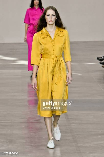 Model walks the runway during the Agnes B. Ready to Wear Spring/Summer 2020 fashion show as part of Paris Fashion Week on September 30, 2019 in...