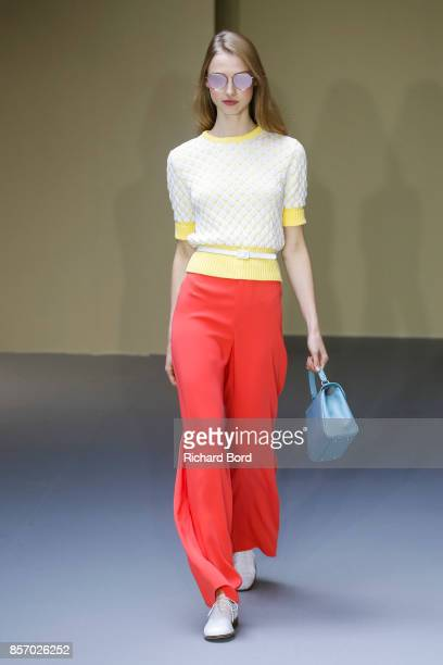 A model walks the runway during the Agnes B show as part of Paris Fashion Week Womenswear Spring/Summer 2018 on October 3 2017 in Paris France