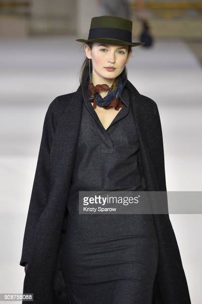 A model walks the runway during the Agnes B show as part of Paris Fashion Week Womenswear Fall/Winter 2018/2019 on March 5 2018 in Paris France