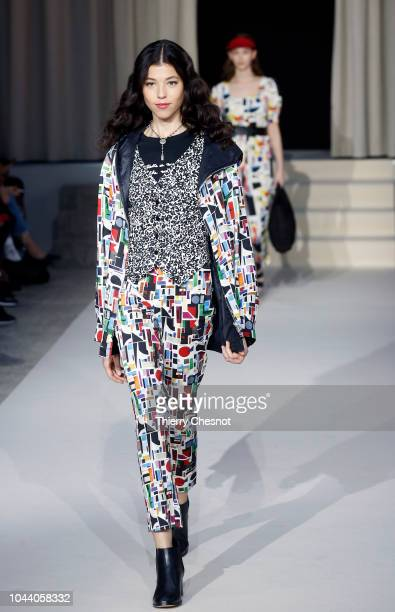 A model walks the runway during the Agnes B show as part of the Paris Fashion Week Womenswear Spring/Summer 2019 on October 1 2018 in Paris France