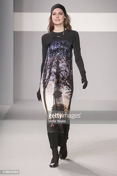 A model walks the runway during the Agnes B show as part of the Paris Fashion Week Womenswear Fall/Winter 20142015 on March 4 2014 in Paris France