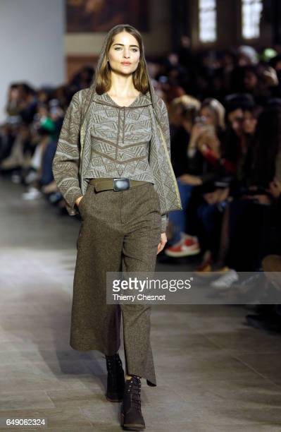 A model walks the runway during the Agnes B show as part of the Paris Fashion Week Womenswear Fall/Winter 2017/2018 on March 7 2017 in Paris France