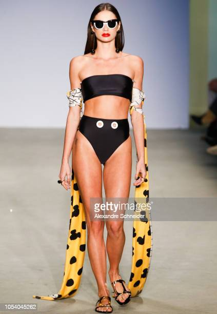 A model walks the runway during the Agua de Coco fashion show during Sao Paulo Fashion Week N46 Winter 2019 at Arca on October 26 2018 in Sao Paulo...