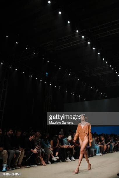 A model walks the runway during the Agua de Coco show during Sao Paulo Fashion Week N46 SPFW Winter 2019 at ARCA on October 26 2018 in Sao Paulo Sao...