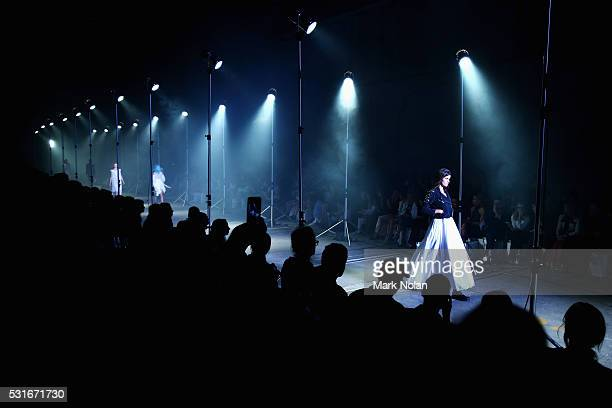 A model walks the runway during the Aje show at MercedesBenz Fashion Week Resort 17 Collections at Carriageworks on May 16 2016 in Sydney Australia