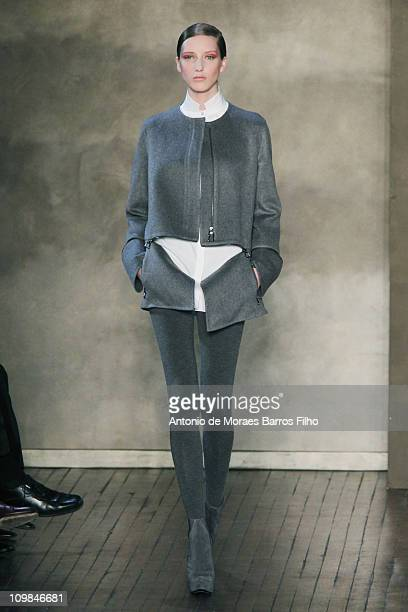 Model walks the runway during the Akris Ready to Wear Autumn/Winter 2011/2012 show during Paris Fashion Week at Salle Wagram on March 6, 2011 in...