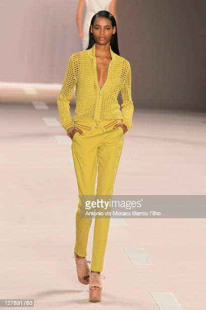 A model walks the runway during the Akris Ready to Wear Spring / Summer 2012 show during Paris Fashion Week at Palais de Chaillot on October 2 2011...