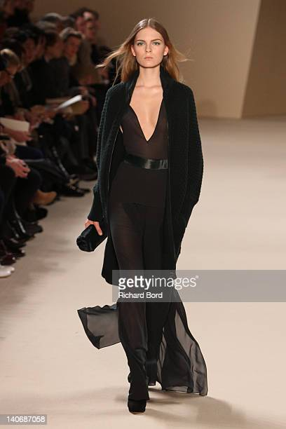 Model walks the runway during the Akris Ready-To-Wear Fall/Winter 2012 show as part of Paris Fashion Week at Palais de Chaillot on March 4, 2012 in...