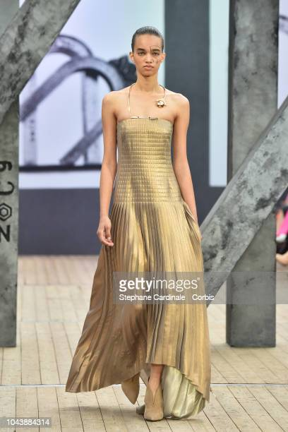 Model walks the runway during the Akris show as part of the Paris Fashion Week Womenswear Spring/Summer 2019 on September 30, 2018 in Paris, France.