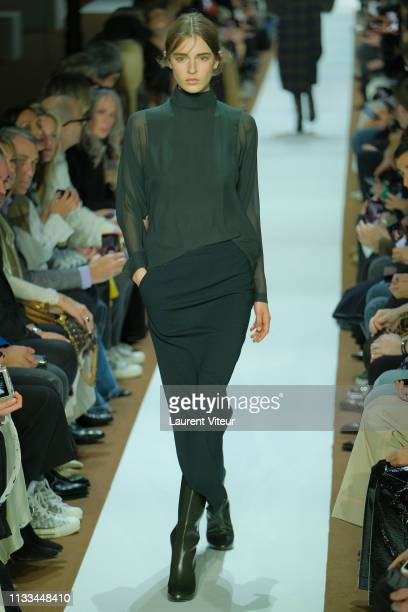 Model walks the runway during the Akris show as part of the Paris Fashion Week Womenswear Fall/Winter 2019/2020 on March 03, 2019 in Paris, France.