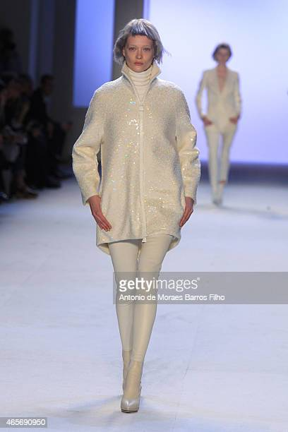 Model walks the runway during the Akris show as part of the Paris Fashion Week Womenswear Fall/Winter 2015/2016 on March 8, 2015 in Paris, France.