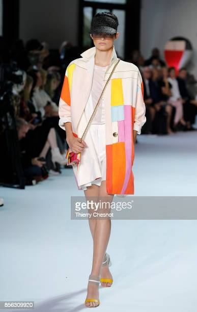 A model walks the runway during the Akris show as part of the Paris Fashion Week Womenswear Spring/Summer 2018 on October 1 2017 in Paris France