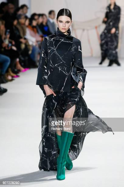 Model walks the runway during the Akris show as part of the Paris Fashion Week Womenswear Fall/Winter 2018/2019 on March 4, 2018 in Paris, France.