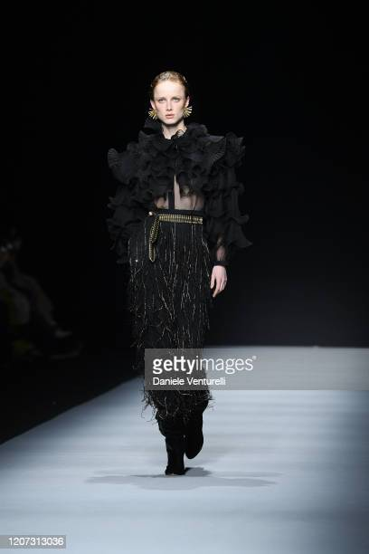 A model walks the runway during the Alberta Ferretti fashion show as part of Milan Fashion Week Fall/Winter 20202021 on February 19 2020 in Milan...