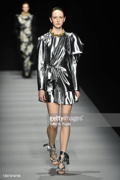 Model walks the runway during the Alberta Ferretti fashion show as part of Milan Fashion Week Fall/Winter 2020-2021 on February 19, 2020 in Milan,...