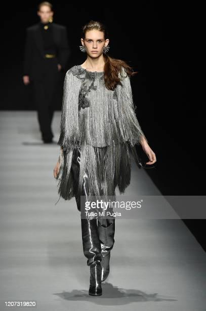 A model walks the runway during the Alberta Ferretti fashion show as part of Milan Fashion Week Fall/Winter 20202021 on February 19 2020 in Milan...