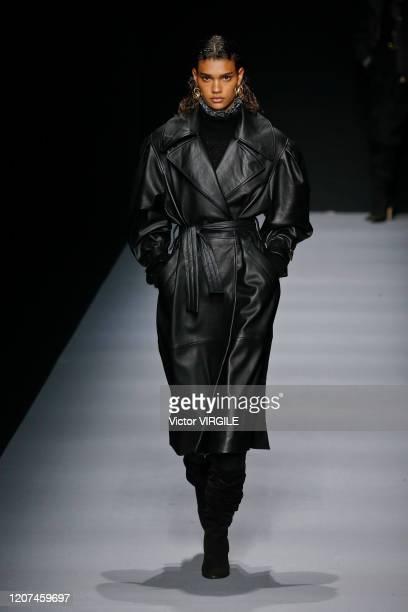 Model walks the runway during the Alberta Ferretti Ready to Wear Fall/Winter 2020-2021 fashion show as part of Milan Fashion Week on February 19,...