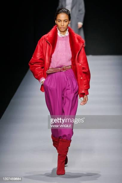 A model walks the runway during the Alberta Ferretti Ready to Wear Fall/Winter 20202021 fashion show as part of Milan Fashion Week on February 19...