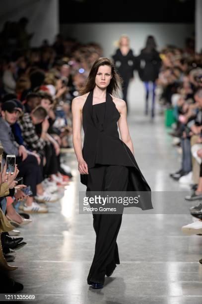 A model walks the runway during the Aleksandar Protic show at Moda Lisboa Awake 2020 on March 08 2020 in Lisboa Portugal