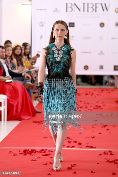 A model walks the runway during the Alex Pike show at BNTB Cannes Fashion Week on May 14 2019 in Cannes France
