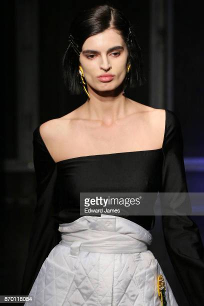 A model walks the runway during the Alexander Arutyunov fashion show at MercedesBenz Fashion Week Tbilisi on November 4 2017 in Tbilisi Georgia