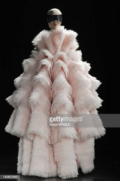 A model walks the runway during the Alexander McQueen as part of Paris Fashion Week Womenswear Fall/Winter 2012 show at Salle Wagram on March 6 2012...