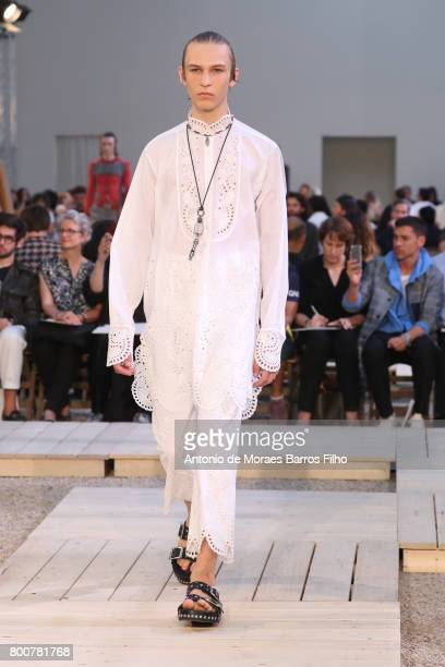 A model walks the runway during the Alexander Mcqueen Menswear Spring/Summer 2018 show as part of Paris Fashion Week on June 25 2017 in Paris France
