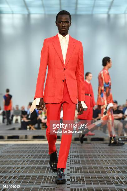 A model jewelry detail walks the runway during the Alexander McQueen Menswear Spring/Summer 2019 show as part of Paris Fashion Week on June 22 2018...