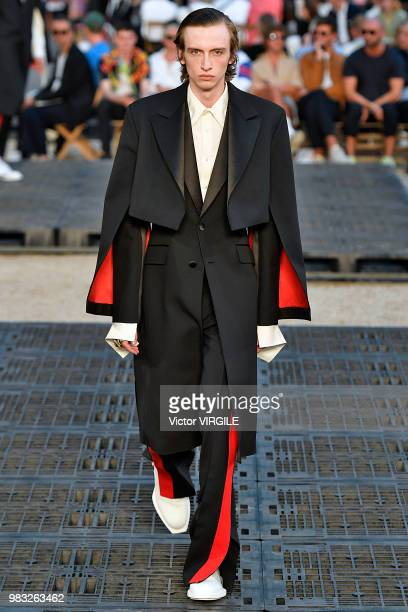 A model walks the runway during the Alexander McQueen Menswear Spring/Summer 2019 fashion show as part of Paris Fashion Week on June 22 2018 in Paris...