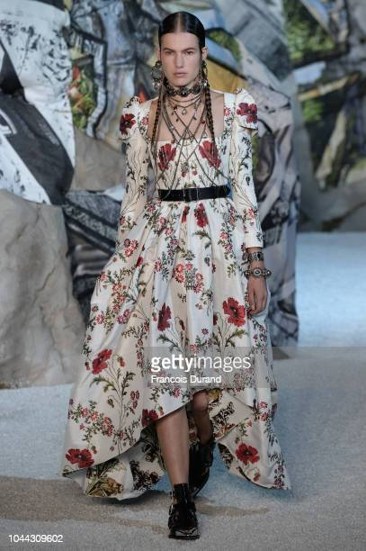 Model walks the runway during the Alexander McQueen Paris show as part of the Paris Fashion Week Womenswear Spring/Summer 2019 on October 1, 2018 in...